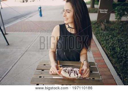 young girl in a cafe enjoying her dessert
