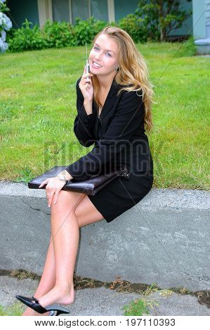 Female blond beauty fashion model expressions outside.