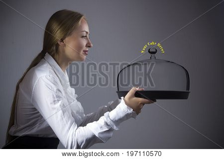 Young blonde woman waitress with a tray in hands