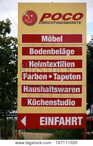MAINZ, GERMANY - JULY 16: A signpost with the inscription entrance as well as offered sales items of the furniture and furnishing market Poco on July 16 2017 in Mainz.