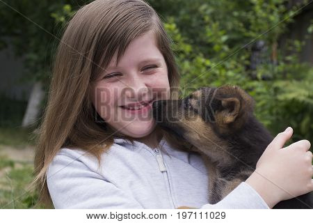 Young dog and teenage girl close-up outdoors