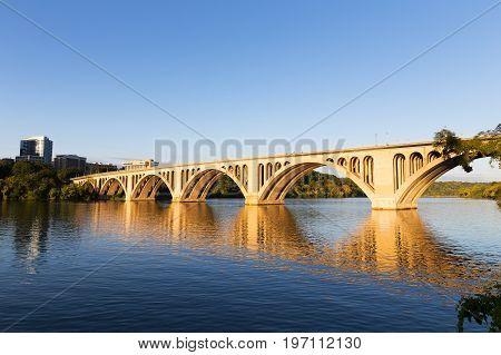Key Bridge at sunrise in Washington DC USA. A view on Key Bridge over Potomac River from Georgetown Park.