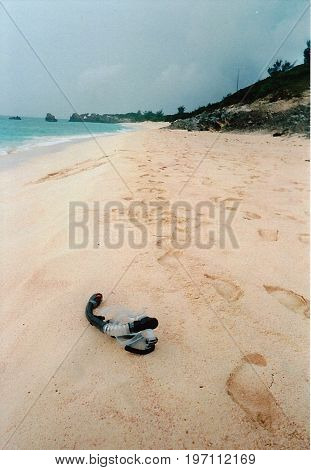 Snorkel on sand beach with footprints in Bermuda