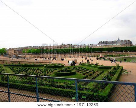 Parisians and tourists in famous Tuileries garden, Paris, France