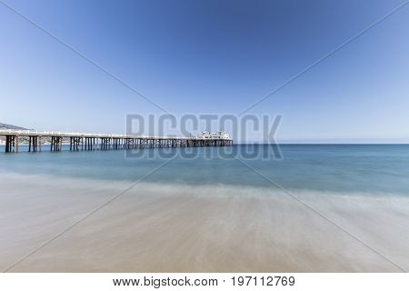 Malibu Pier with motion blur water near Los Angeles in Southern California.