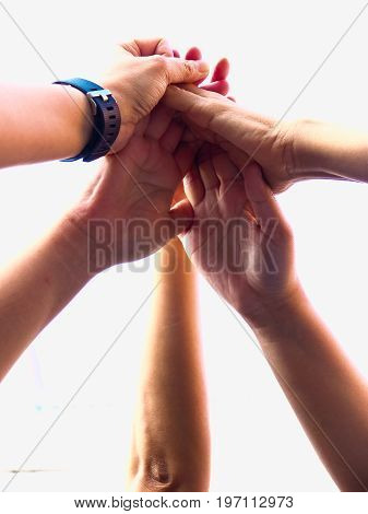 Close up  of young people putting their hands together/Team work business team showing unity with their hands together isolate on white background