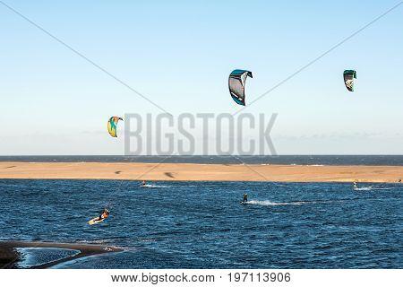 Jose Ignacio, Uruguay, Kiters On The Garzon Bay Are Using Last Summer Days