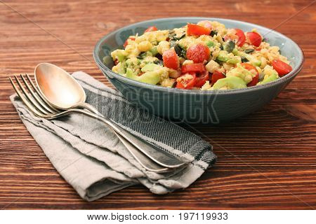 Chickpeas lentils avocado tomato cucumber salad. Low fat eating healthy concept.