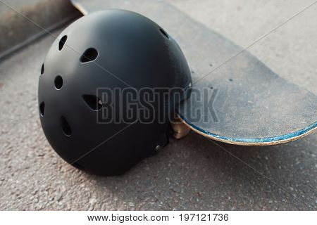 Skateboard halmet and safety acessrise. Head care protection from injoury. Extreme sport background. Headwear stuff for skater