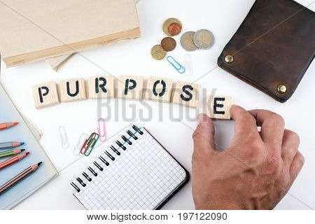 Purpose concept. Wooden letters on a white background.