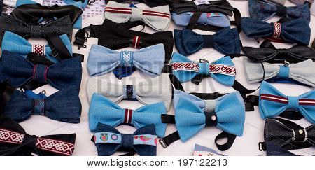 Many bow ties blue color handmade background