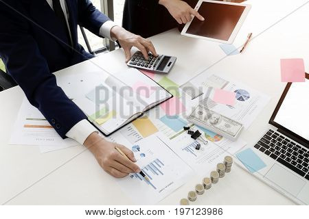 Audit conceptBookkeeper Team or financial inspector and secretary making report Financial Planning Accounting Report in Spreadsheet . Internal Revenue Service inspector checking financial document.