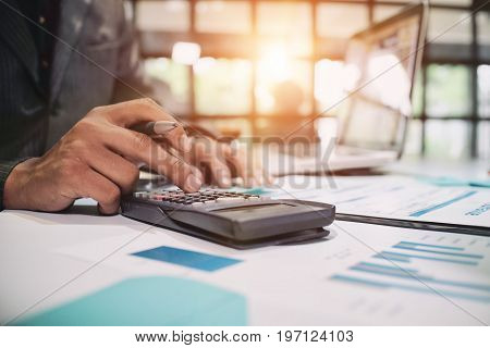 Insurance agent using calculator for medical insurance the policy and explain insurance policy to customer. life insurance concept.