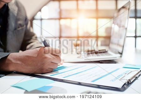 Insurance agent holding pen medical insurance the policy and explain insurance policy to customer. life insurance concept.