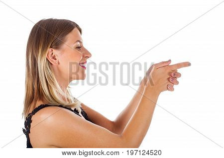 Picture of a sexy young woman having fun indoors pointing with her hands like a handgun on isolated background