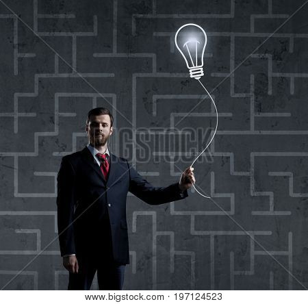 Businessman standing over labyrinth background. Business, strategy, concept.