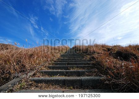 trail to the top of a mountain in the mount Aso area in autumn Japan