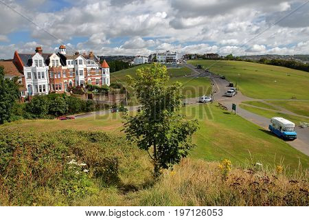 HASTINGS, UK - JULY 23, 2017: View of the West Hill with colorful Georgian houses on the left side along Priory road