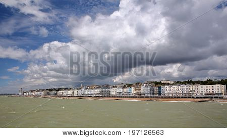 View of the seafront from the Pier with a beautiful cloudy sky, Hastings, UK