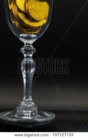 a glass full of (chocolate candies) gold coins symbolizing rich and fortune