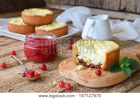 Mini Cowberry Cheesecake In Muffin Forms. Served In Cutting Board With Jam And Berries. Copy Space