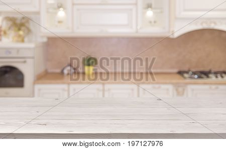Blurred kitchen interior background with wooden planks table in front