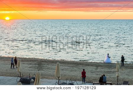 JURMALA, LATVIA - JULY 19, 2017: Colorful sunset at public beach in Jurmala - famous resort at the Baltic Sea, Latvia, Europe
