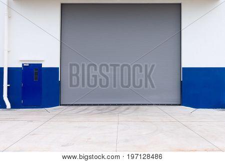 Automatic roller shutter door of storage warehouse.