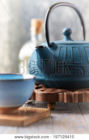 Close up of a traditional teapot and teacup