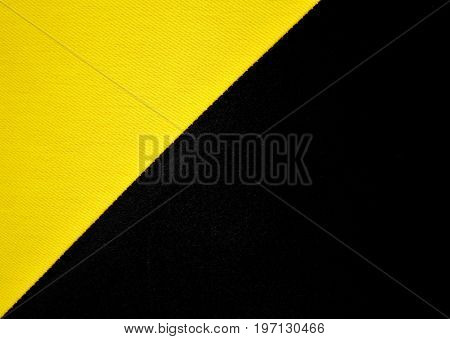 Yellow and black natural linen fabric texture background. Grid pattern canvas texture. Symbol of anarchy in trade. Color block background