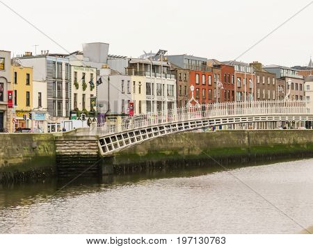 DUBLIN, IRELAND - NOVEMBER 06, 2013: Ha Penny Bridge. Pedestrian cast-iron bridge, symbol of the Dublin