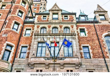 Quebec City Canada - May 29 2017: Old town view of hotel Fairfmont Chateau Frontenac brick castle building with flags