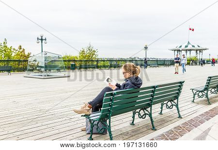 Quebec City, Canada - May 29, 2017: Old Town View Of Dufferin Terrace Wooden Boardwalk With Young Wo