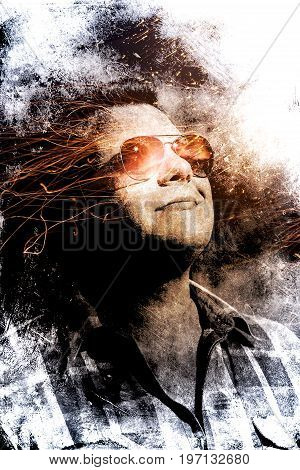 Double exposition of a portrait of a man. Art illustration of a man's portrait. A conceptual drawing of a guy in glasses. Portrait of a man in sparks of fire. Dark Portrait of a human on fire.