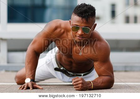 Hot Beautiful Black Guy With Bulging Muscles Posing Against The