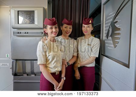 DOHA, QATAR - CIRCA JUNE, 2017: Qatar Airways crew members on board of Boeing 777. Qatar Airways is the state-owned flag carrier of Qatar.