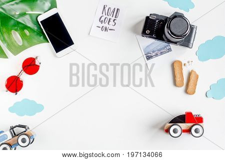 planing trip with child with mobile and camera on white background top view space for text