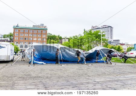 Quebec City, Canada - May 30, 2017: People Setting Up Large Tent By Old Port Market For Local Festiv