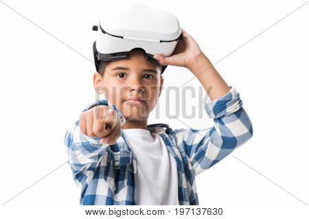 African American Boy Wearing Virtual Reality Headset And Pointing At Camera Isolated On White