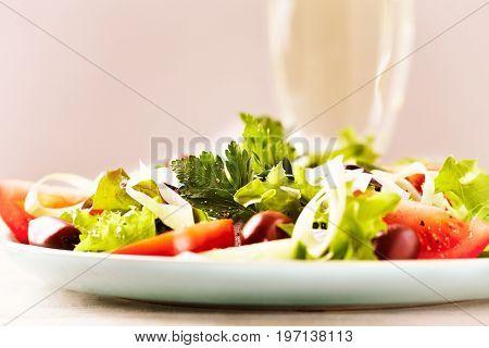 Healthy salad with tomatoes and kalamata olives