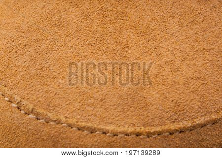 Brown leather background suede texture with stitching