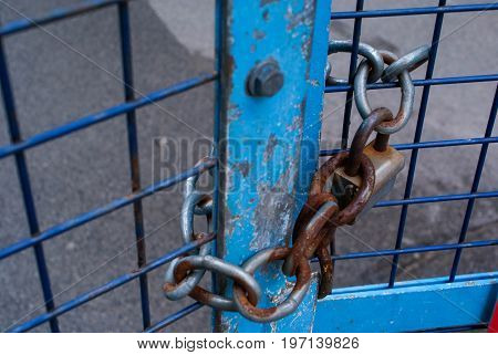 Lock on a chain link security fence. background for graphic design.
