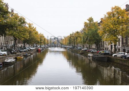 Amsterdam, Netherlands, October 2016, Canal on Amstel river wide angle