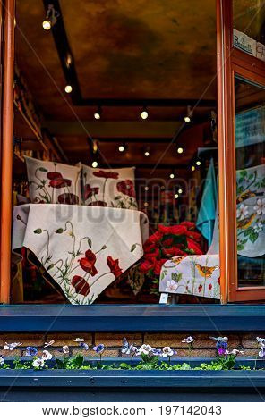 Quebec City, Canada - May 30, 2017: Closeup Of Storefront Window With Pansy Flowers In Crate Or Bed