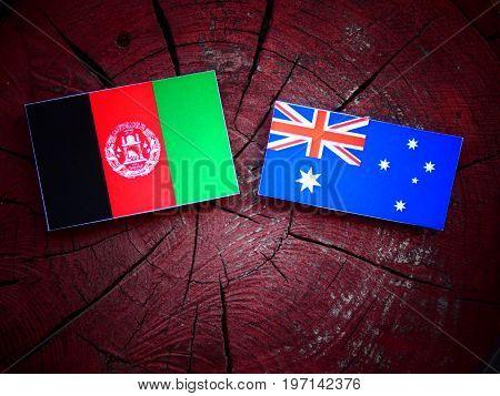 Afghani Flag With Australian Flag On A Tree Stump Isolated