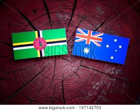Dominica Flag With Australian Flag On A Tree Stump Isolated
