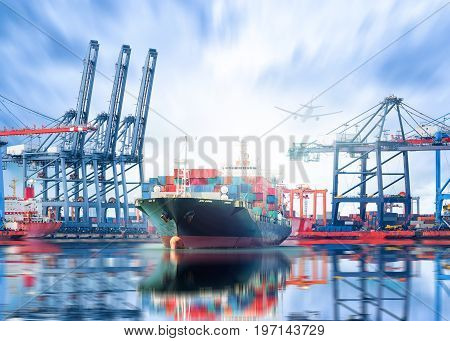 Logistics and transportation of International Container Cargo ship and Cargo plane with ports crane bridge in harbor at Twilight sky for logistic import export background and transport industry.