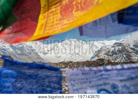 The prayer flag and mount Annapurna I the 10th highest peak of the world in Annapurna conservation area of Nepal.