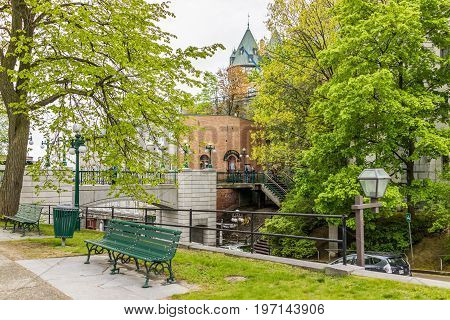 Quebec City Canada - May 30 2017: View of Porte Prescott bridge and Chateau Frontenac by old town street called Cote de la Montagne with stone buildings