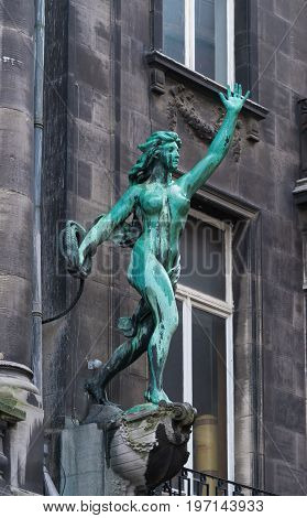 ANTWERP BELGIUM - OCTOBER 2 2016: Bronze statue of a woman throwing a rope in the city center